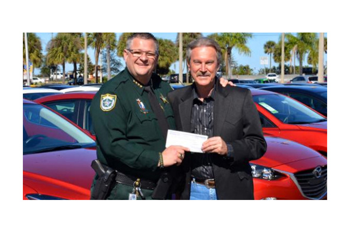 A.J. Hiers gives donation check to Brevard County Sheriff's Office
